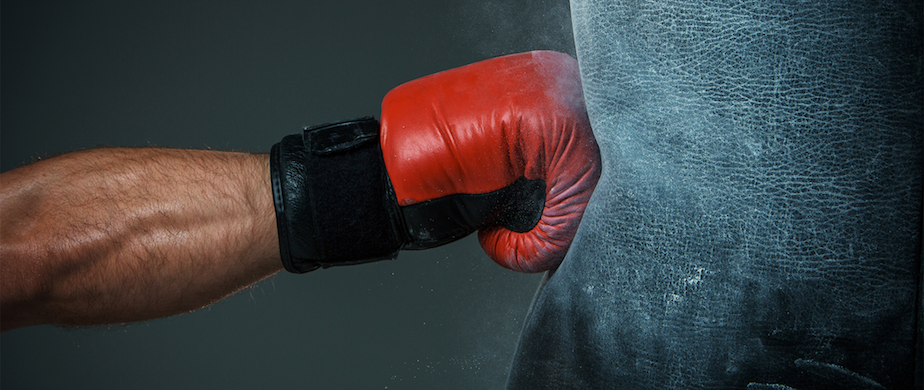 picture of a red boxing glove hitting a punching bag