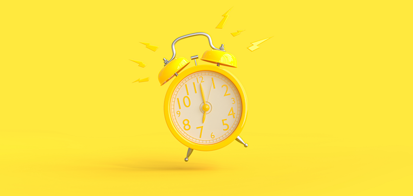 image of a yellow alarm clock against a yellow background