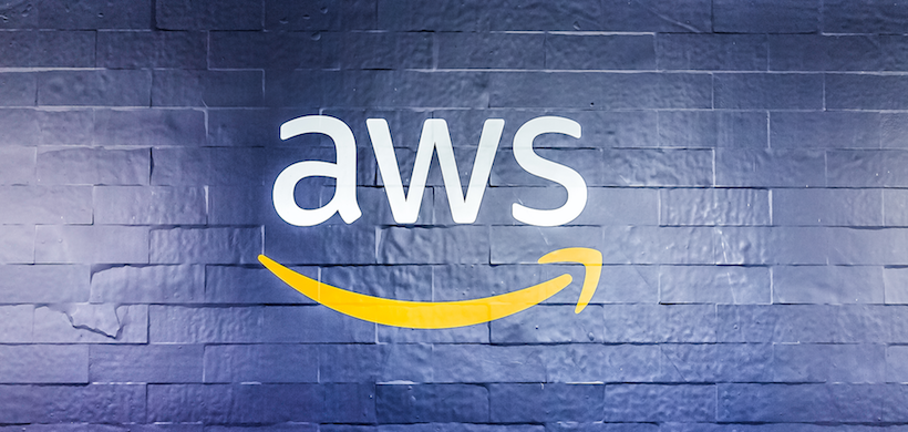 image of the painted aws logo on a brick wall