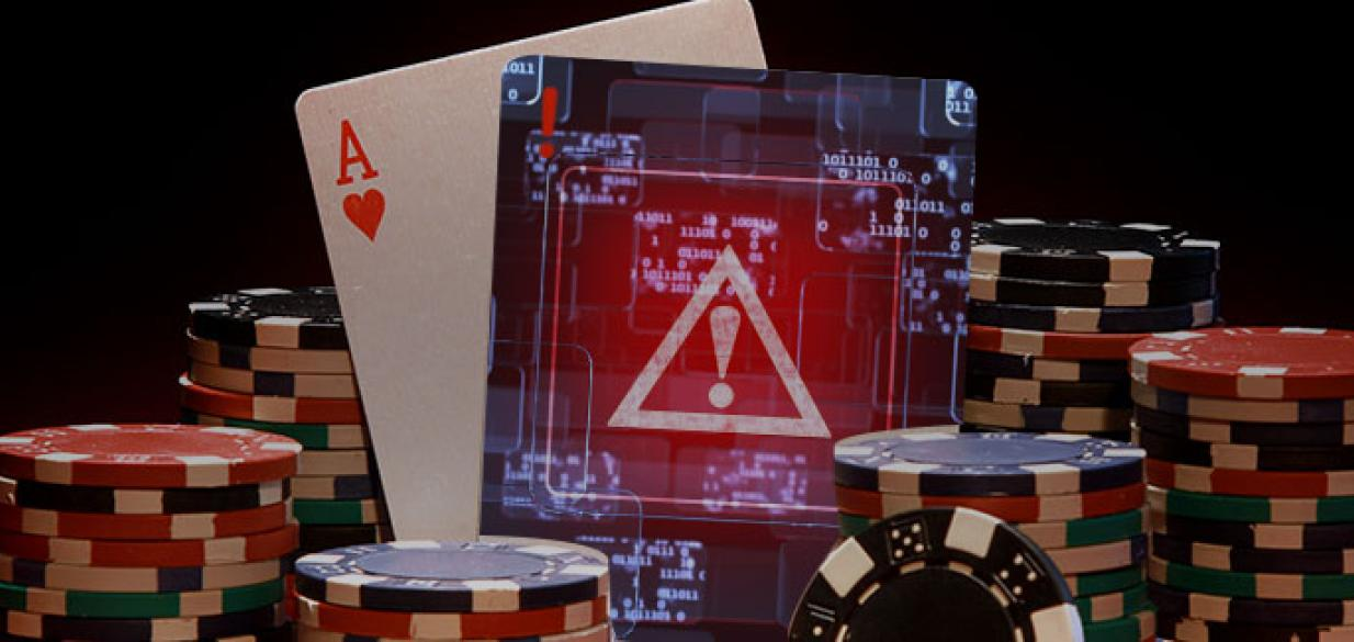picture of poker cards and chips on a table, with one card showing a digital warning sign